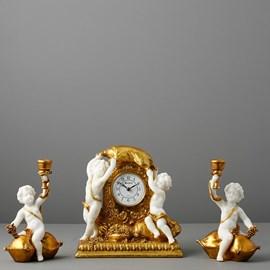 Clock with 2 Candlesticks / cherubs